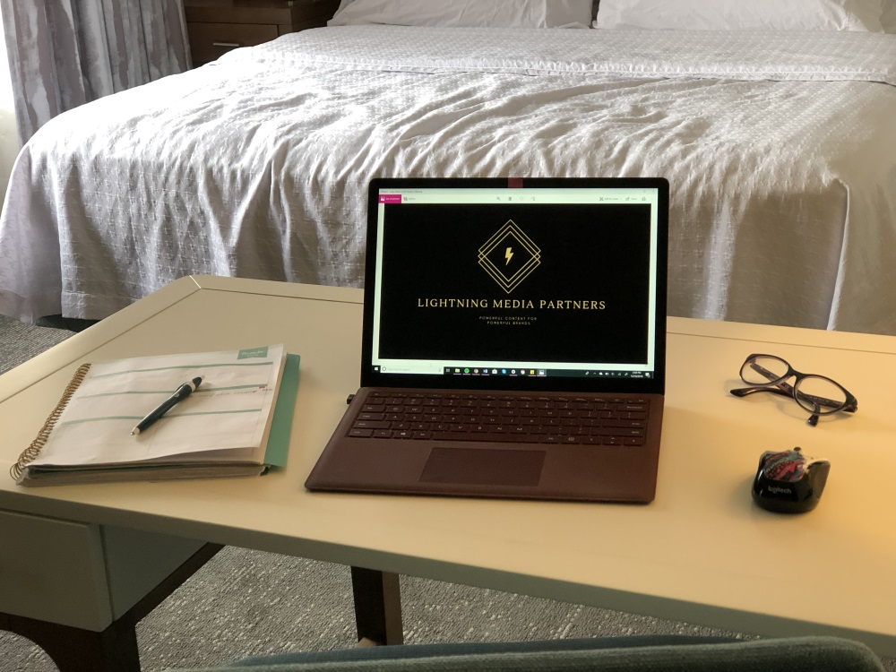 open laptop with Lightning Media Partners logo on screen